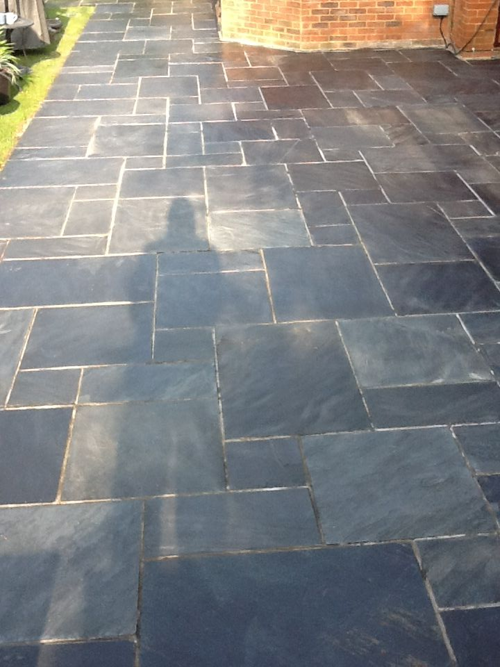 Tile doctor showing the results of cleaning slate on a for Terrace tiles