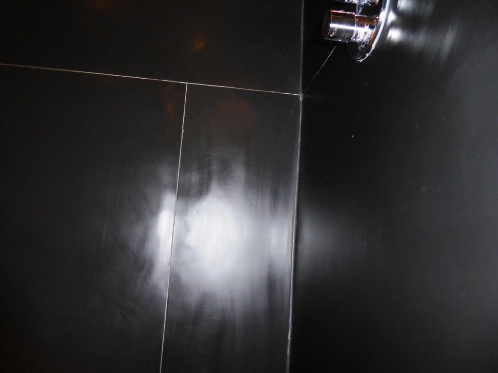 Slate shower after burnishing Churt