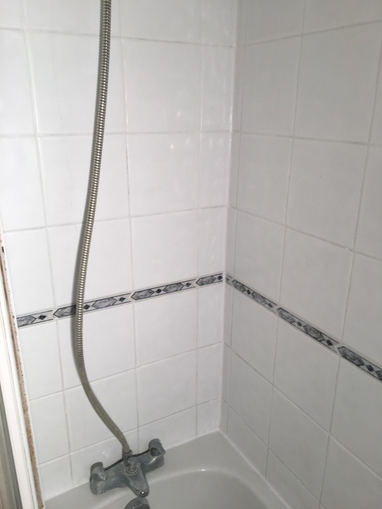 Dirty Ceramic Bath Tiles in Chessington after cleaning