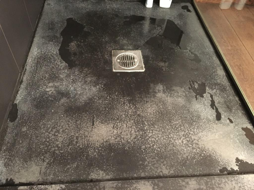 Badly Marked Slate Shower Tray in Clapham Before Restoration