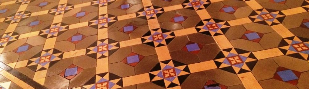 Heavily Soiled Victorian Tiled Floor Cleaned and Sealed at a Cafe in Chertsey
