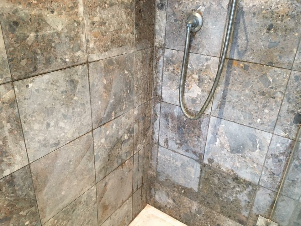 Restoring Ruined Marble Wall Tiles In A Surrey Shower