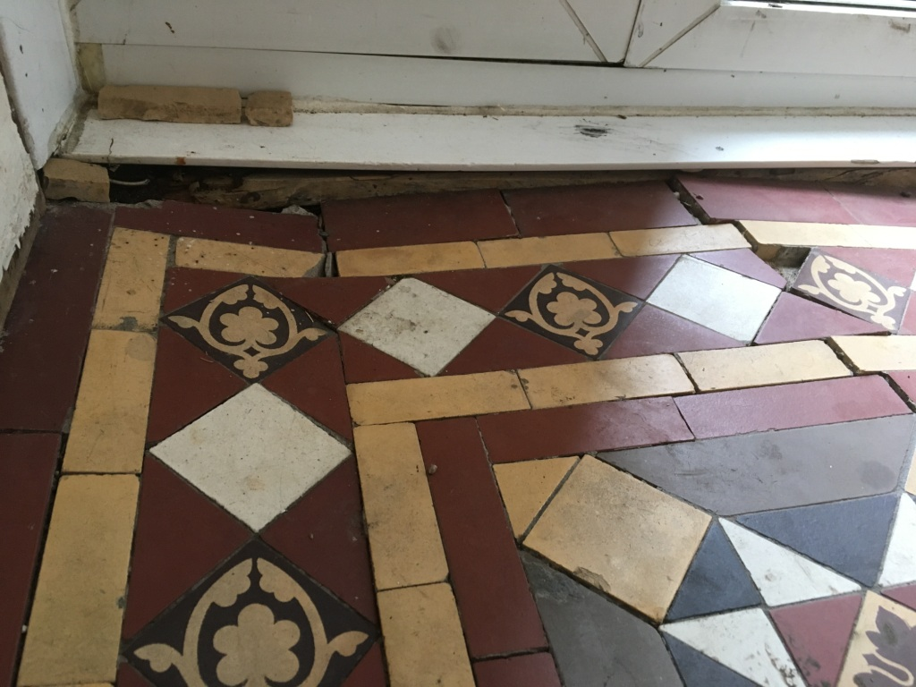 Victorian Tiled Hallway Floor Before Rebuild in Epsom