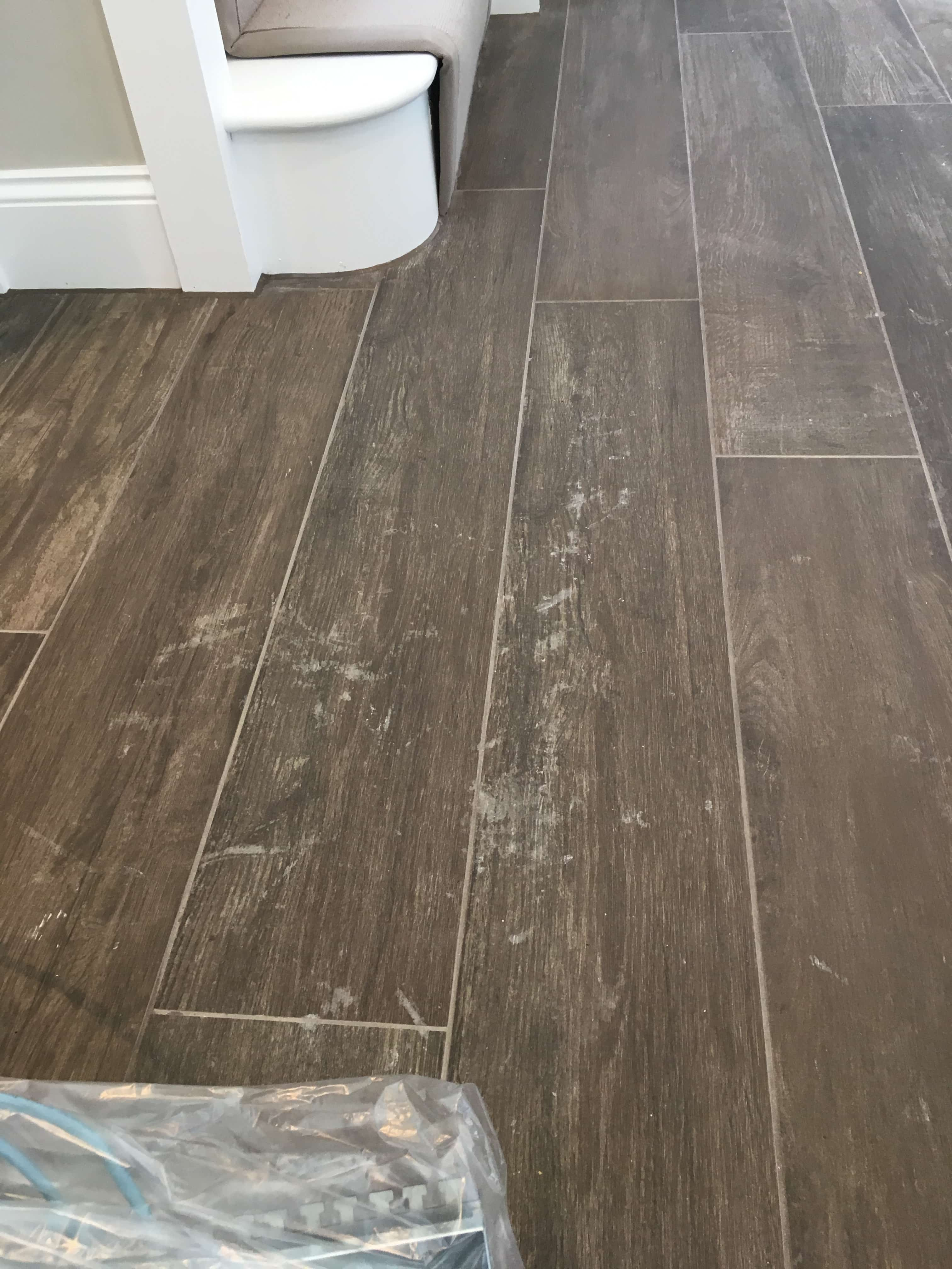 Grout Haze on Wood Effect Ceramic Tiles Before Removal Guildford